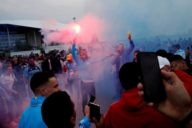 Soccer Football - Europa League Final - Olympique de Marseille vs Atletico Madrid - Lyon, France - May 16, 2018 Marseille fans with flares in Lyon before the match REUTERS/Denis Balibouse