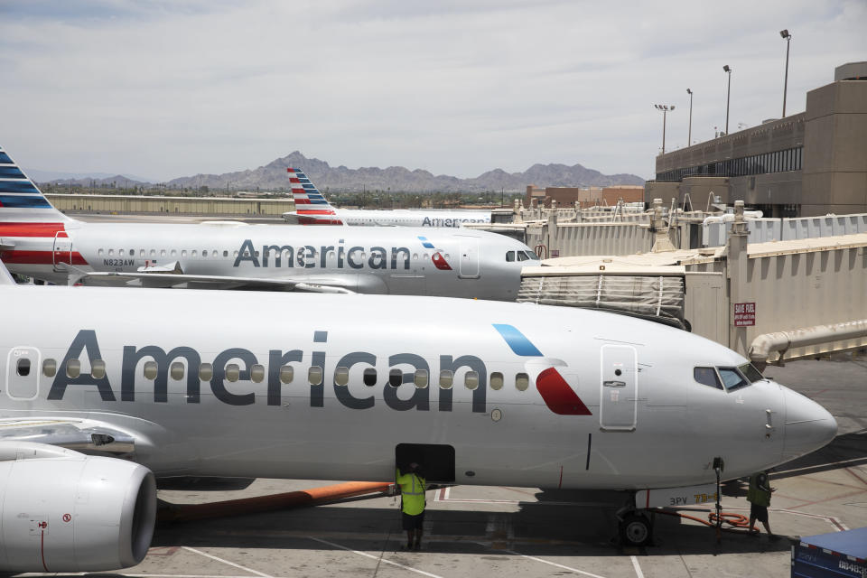FILE - This June 7, 2021, file photo shows an American Airlines aircraft at Phoenix Sky Harbor International Airport in Phoenix. A key senator is asking six U.S. airlines, including American, to explain the high rates of delayed and canceled flights this summer, and she's asking whether there are labor shortages despite the airlines getting billions in federal aid to keep workers on the job. (AP Photo/Jenny Kane, File)