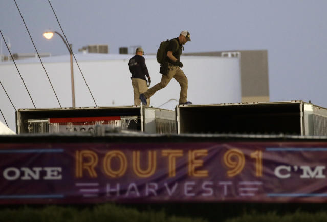 <p>FBI agents walk on the roof of boxes inside the concert grounds where a mass shooting occurred in Las Vegas, Tuesday, Oct. 3, 2017. (Photo: John Locher/AP) </p>