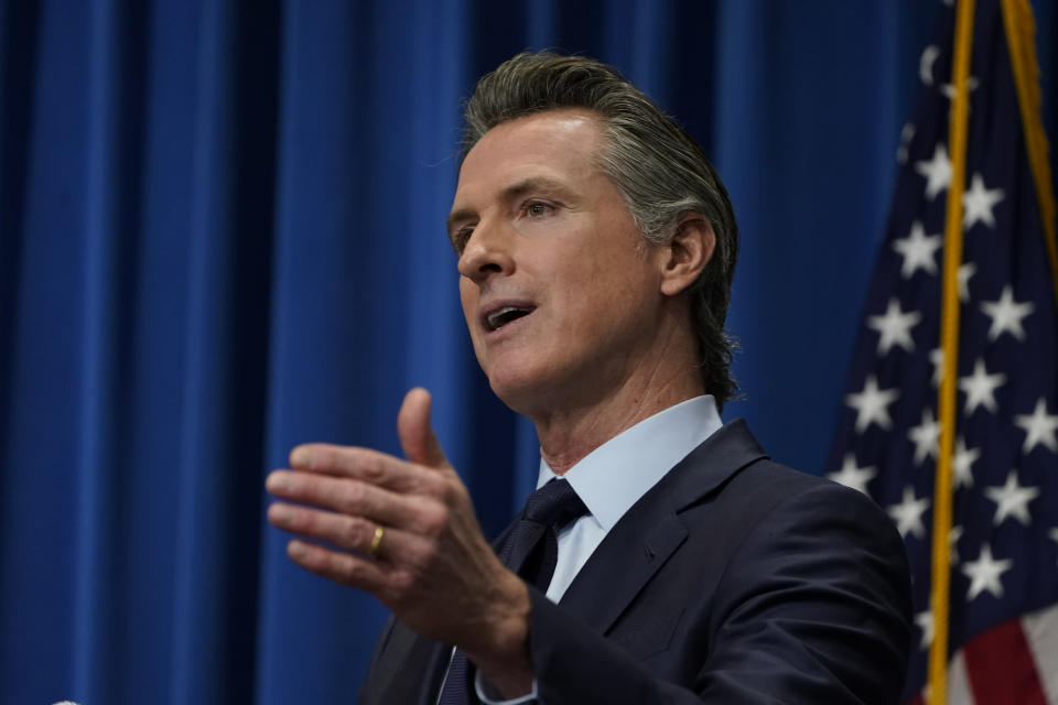 FILE — In this Jan. 8, 2021 file photo California Gov. Gavin Newsom outlines his 2021-2022 state budget proposal during a news conference in Sacramento, Calif. On Monday, Jan. 25, 2021 Newsom and Assembly Speaker Anthony Rendon and Senate President Pro Tem Tempore Toni Atkins announced a proposal that would extend pandemic eviction protections through the end of June and pay up to 80% of some tenants' unpaid rent. The proposal must still be approved by the state Legislature. (AP Photo/Rich Pedroncelli, File, Pool)
