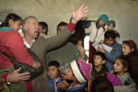 U.S. Sen. Joseph Biden, D-Del., Chairman of the U.S Senate's Foreign Relations Committee, waves as he talks to Afghan children during a visit to the Ariana primary school in Kabul, Jan. 12, 2002. Biden was on a two-day visit to the Afghan capital. (AP Photo/Enric Marti)