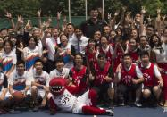 Canadian Prime Minister Justin Trudeau poses with a number of Chinese students, officials and many others, including former NBA star Yao Ming in Shanghai, China, on Sept. 2, 2016. The Canadian Press/Adrian Wyld