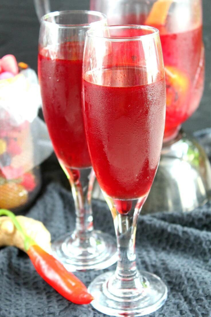 """<p> Pour 70 oz. of cherry juice into a large saucepan and add 4 orange peels, 1 small, red chili, 3 cinnamon sticks, 10 cloves, and 6 slices of peeled ginger. Simmer for five minutes, then turn off the heat. Strain if you'd prefer a smoother texture. Then, cool and chill for up to 2 days. Serve in a pitcher and enjoy. </p><p><em> Recipe from <a href=""""https://theseamanmom.com/blood-punch-recipe-non-alcoholic/"""" rel=""""nofollow noopener"""" target=""""_blank"""" data-ylk=""""slk:Easy Peasy Creative Ideas."""" class=""""link rapid-noclick-resp"""">Easy Peasy Creative Ideas. </a></em></p>"""