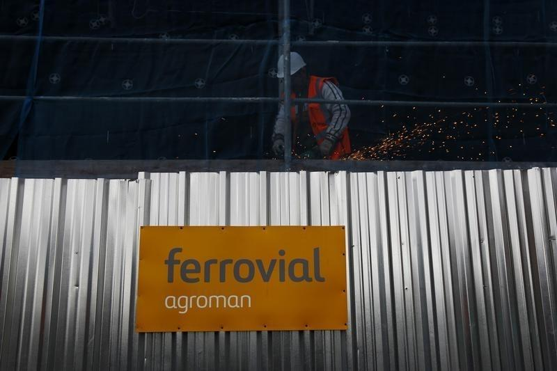 A welder works at a Ferrovial construction site, of new residential buildings, in Madrid