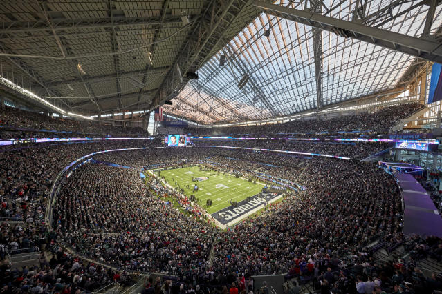 FILE - This Feb. 4, 2018, file photo shows a general view of U.S. Bank Stadium during the pregame of the NFL Super Bowl 52 football game in Minneapolis. In its early days, the NFL often relied on baseball stadiums for its teams. Often, the football team took the name of the baseball team, looking to create the illusion there was a connection between the teams. But once pro football expanded and was shown for free on television, the sport was on its way. (AP Photo/Adam Bettcher, File)
