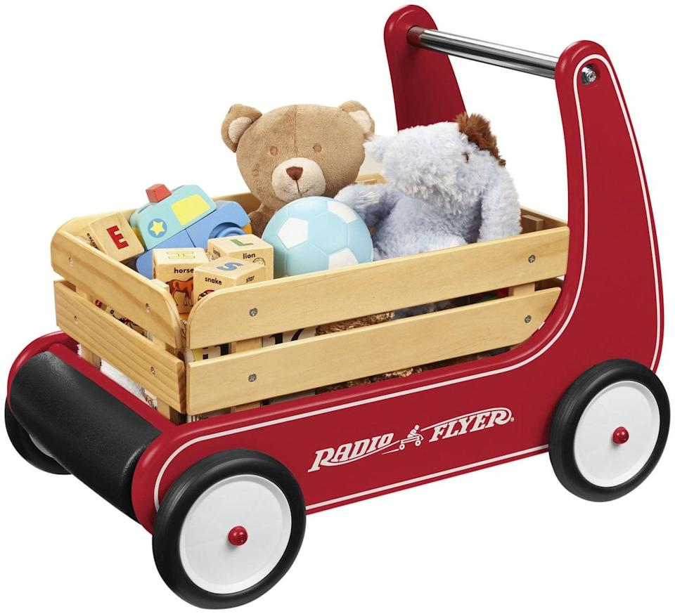 "<p>What's better than a classic Radio Flyer wagon? One that an early (or soon-to-be) walker can operate on their own. The brand's adorable <a href=""https://www.popsugar.com/buy/Classic-Wagon-Walker-328386?p_name=Classic%20Wagon%20Walker&retailer=amazon.com&pid=328386&price=79&evar1=moms%3Aus&evar9=25800161&evar98=https%3A%2F%2Fwww.popsugar.com%2Fphoto-gallery%2F25800161%2Fimage%2F44870047%2FRadio-Flyer-Classic-Wagon-Walker&list1=gifts%2Camazon%2Choliday%2Ctoys%2Cgift%20guide%2Cparenting%2Cbabies%2Cgifts%20for%20kids%2Ckid%20shopping%2Choliday%20living%2Choliday%20for%20kids%2Cgifts%20for%20toddlers%2Cbest%20of%202019&prop13=api&pdata=1"" class=""link rapid-noclick-resp"" rel=""nofollow noopener"" target=""_blank"" data-ylk=""slk:Classic Wagon Walker"">Classic Wagon Walker</a> ($79) lets tots cart around their prized possessions while offering stability. </p>"
