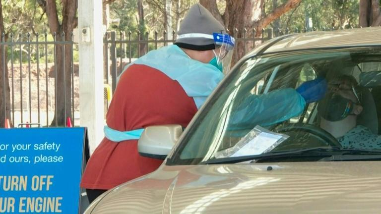 Queues at drive-through Covid testing as Sydney extends lockdown