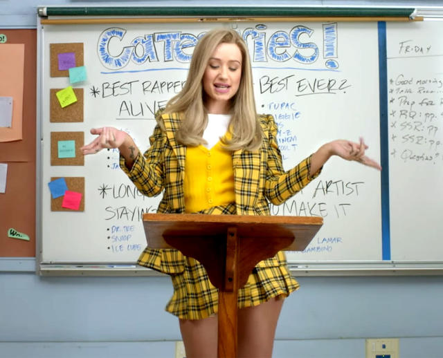 """<p>In 2014, the rapper went back to school as she showed her appreciation for beloved high school movie <em>Clueless</em> in the video for her hit song """"Fancy."""" She wore a cute yellow-and-navy plaid ensemble with a supershort skirt in the scene taking place in debate class. (Photo: Vevo) </p>"""