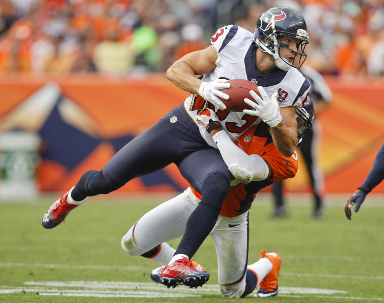 Houston Texans wide receiver Kevin Walter (83) brings down a pass as he is hit by Denver Broncos strong safety Chris Harris (25) in the fourth quarter of an NFL football game Sunday, Sept. 23, 2012, in Denver. (AP Photo/David Zalubowski)