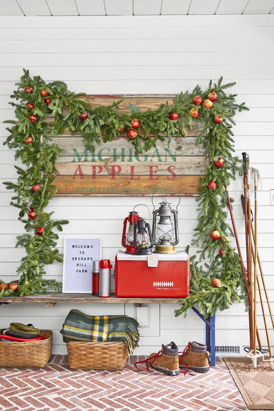 """<p>To make this Fraser fir creation, use a skewer to puncture a hole through an apple, close to the center, then string wire through the fruit and secure wire to the garland.</p><p><a class=""""link rapid-noclick-resp"""" href=""""https://www.amazon.com/Vickerman-Unlit-Camden-Fir-Garland/dp/B0029OL3H4?tag=syn-yahoo-20&ascsubtag=%5Bartid%7C10050.g.1247%5Bsrc%7Cyahoo-us"""" rel=""""nofollow noopener"""" target=""""_blank"""" data-ylk=""""slk:SHOP GARLAND"""">SHOP GARLAND</a></p>"""
