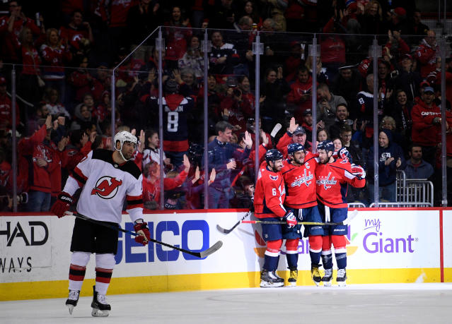 Washington Capitals left wing Alex Ovechkin (8), of Russia, celebrates his goal with Tom Wilson, right, and Michal Kempny, third from right, during the first period of an NHL hockey game as New Jersey Devils left wing Patrick Maroon, left, skates by, Saturday, April 7, 2018, in Washington. (AP Photo/Nick Wass)