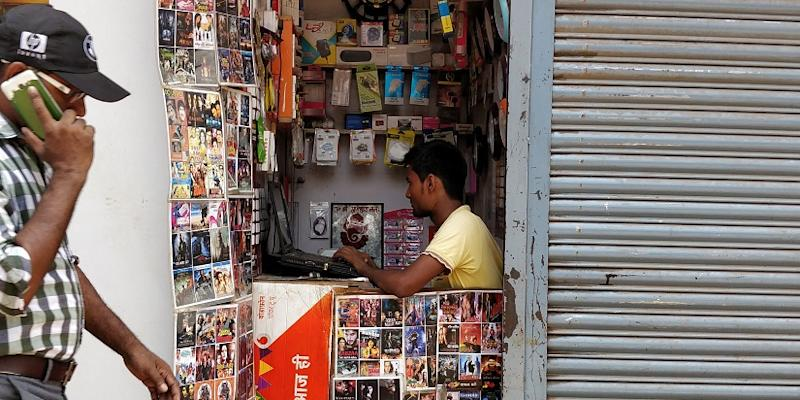 At this hole-in-the-wall shop in Saki Naka, migrant workers stock up the latest Bhojpuri, Tollywood and Nepali movies on their phones, with resolution versions costing Rs 20. A low-resolution print costs Rs 10.