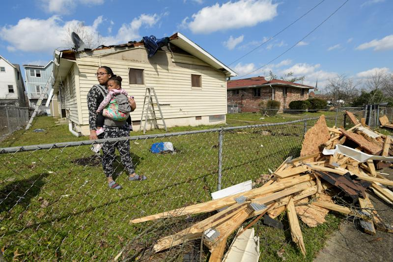 Dominique Hammond and her daughter Analise Hammond are seen outside their home in North Nashville following devastating tornadoes.