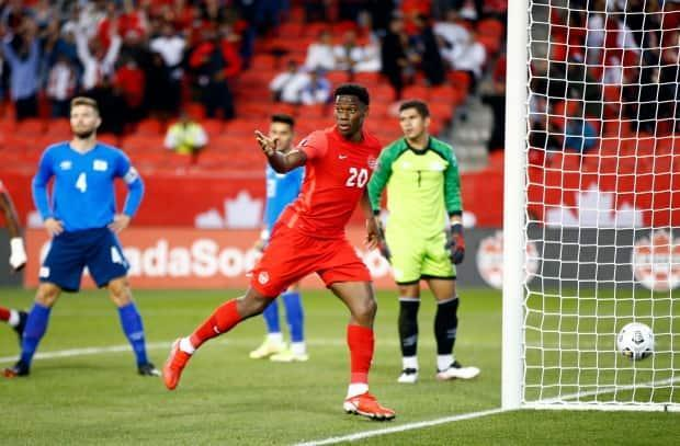Canada's Jonathan David celebrates a goal during a 3-0 win over El Salvador in 2022 World Cup qualifying on Wednesday. (Vaughn Ridley/Getty Images - image credit)