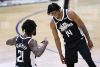 Los Angeles Clippers guard Patrick Beverley, left, celebrates with guard Terance Mann after scoring during the second half in Game 3 of the NBA basketball Western Conference Finals against the Phoenix Suns Thursday, June 24, 2021, in Los Angeles. (AP Photo/Mark J. Terrill)