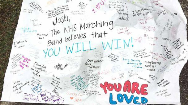 PHOTO: The Norcross High School marching band made a poster to carry as they marched to Josh Libman's house Thursday. (Keira Miller)
