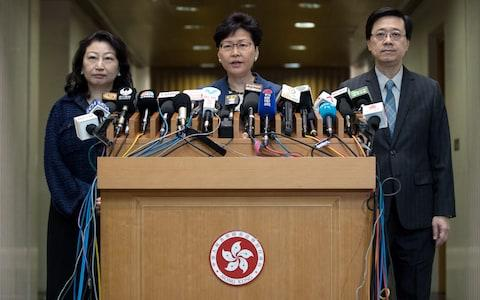Hong Kong Chief Executive Carrie Lam, flanked by justice secretary Teresa Cheng (left) and Security John Lee Ka-chiu, security security - Credit: JEROME FAVRE/EPA-EFE/REX