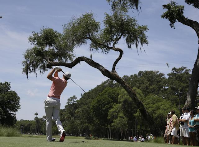 Justin Rose of England, hits from the sixth tee during the first round of The Players championship golf tournament at TPC Sawgrass, Thursday, May 8, 2014 in Ponte Vedra Beach, Fla. (AP Photo/Lynne Sladky)