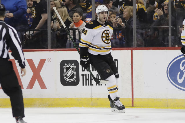 Boston Bruins' Jake DeBrusk celebrates after scoring a goal during the second period of an NHL hockey game against the New York Islanders, Saturday, Jan. 11, 2020, in New York. (AP Photo/Frank Franklin II)