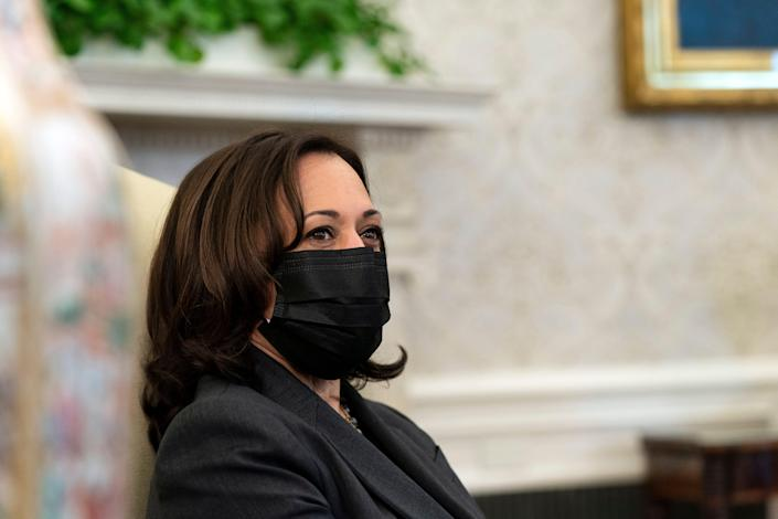 Vice President Kamala Harris listens as President Joe Biden speaks during a meeting about cancer in the Oval Office of the White House on Wednesday.