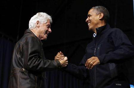 Former U.S. President Bill Clinton introduces U.S. President Barack Obama during a campaign rally in Bristow