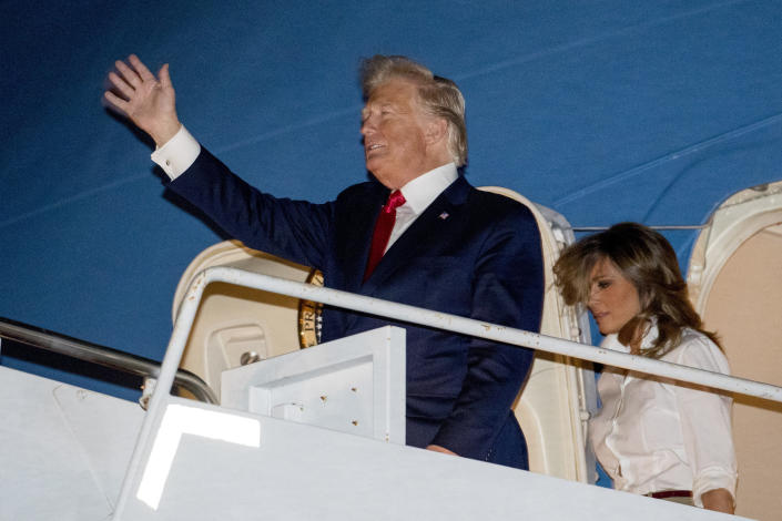 President Donald Trump and first lady Melania Trump arrive at Palm Beach International Airport at West Palm Beach, Fla., Friday, Dec. 20, 2019. (AP Photo/Andrew Harnik)