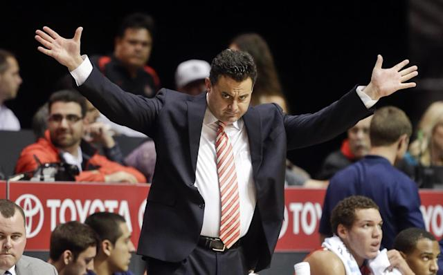 Arizona coach Sean Miller gestures to his team against San Diego State during the first half of an NCAA college basketball game Thursday, Nov. 14, 2013, in San Diego. (AP Photo/Lenny Ignelzi)