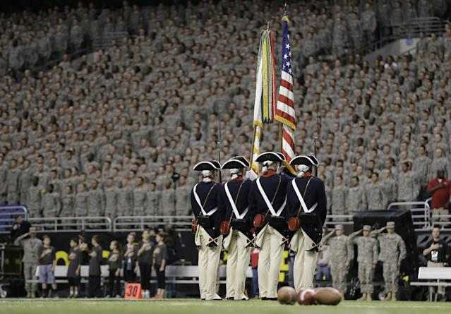 A color guard takes the field for the national anthem prior to the U.S. Army All-American Bowl football game, Saturday, Jan. 4, 2014, in San Antonio. (AP Photo/Eric Gay)