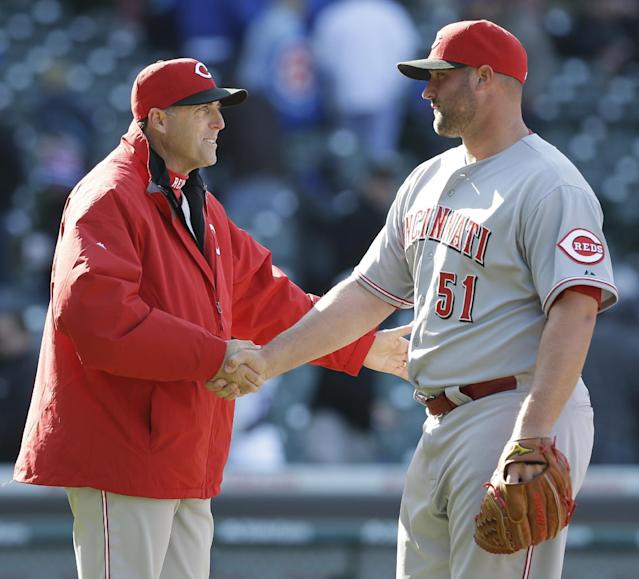 Cincinnati Reds manager Bryan Price, left, celebrates with closer Jonathan Broxton after they defeated the Chicago Cubs 4-1 in a baseball game in Chicago, Friday, April 18, 2014. (AP Photo/Nam Y. Huh)