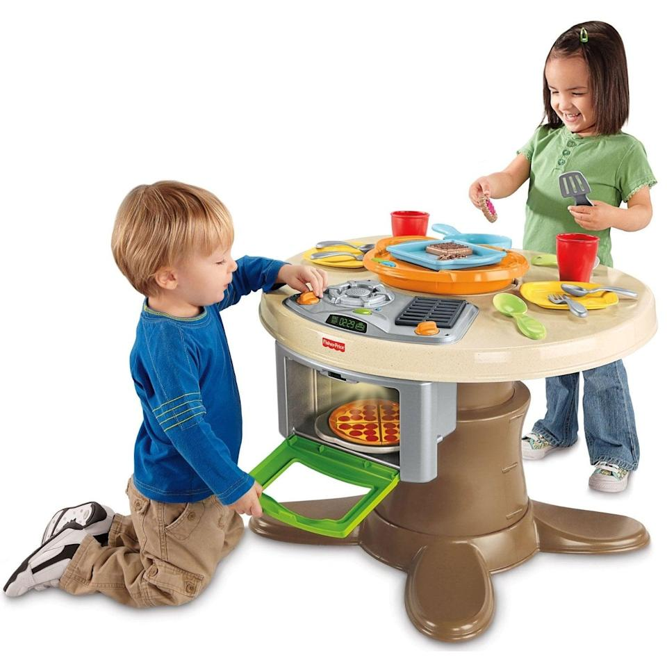 "<p>The play kitchen gets a lot of attention, but Fisher-Price's <a href=""https://www.popsugar.com/buy/Servin-Surprises-Kitchen-amp-Table-5291?p_name=Servin%27%20Surprises%20Kitchen%20%26amp%3B%20Table&retailer=amazon.com&pid=5291&price=170&evar1=moms%3Aus&evar9=25800161&evar98=https%3A%2F%2Fwww.popsugar.com%2Fphoto-gallery%2F25800161%2Fimage%2F25800196%2FFisher-Price-Servin-Surprises-Kitchen-Table&list1=gifts%2Choliday%2Cgift%20guide%2Cparenting%2Ctoddlers%2Cfisher-price%2Clittle%20kids%2Ckid%20shopping%2Choliday%20living%2Choliday%20for%20kids%2Cgifts%20for%20toddlers%2Cbest%20of%202019&prop13=api&pdata=1"" class=""link rapid-noclick-resp"" rel=""nofollow noopener"" target=""_blank"" data-ylk=""slk:Servin' Surprises Kitchen & Table"">Servin' Surprises Kitchen & Table</a> ($170) may be the new hot play area at your home. The table ""recognizes"" food items as they are placed on the grill or in the oven, plays songs about the food, and comes with plenty of kid-favorite food items like pizza and cookies. When food fun is done, the grill flips over and converts into an activity table so that more fun times can be had by all.</p>"