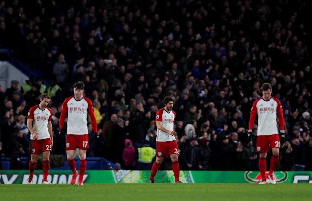 "Soccer Football - Premier League - Chelsea vs West Bromwich Albion - Stamford Bridge, London, Britain - February 12, 2018 West Bromwich Albion's Ahmed Hegazi, Grzegorz Krychowiak, Oliver Burke and Craig Dawson look dejected after Chelsea's second goal was scored by Victor Moses Action Images via Reuters/Andrew Couldridge EDITORIAL USE ONLY. No use with unauthorized audio, video, data, fixture lists, club/league logos or ""live"" services. Online in-match use limited to 75 images, no video emulation. No use in betting, games or single club/league/player publications. Please contact your account representative for further details."