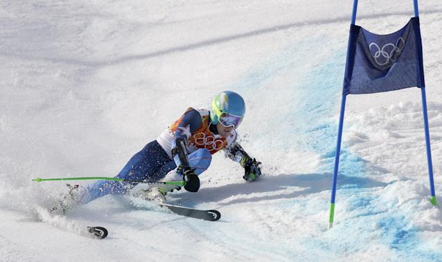 United States' Ted Ligety skis past a gate to win the gold medal in the men's giant slalom at the Sochi 2014 Winter Olympics, Wednesday, Feb. 19, 2014, in Krasnaya Polyana, Russia.(AP Photo/Luca Bruno)