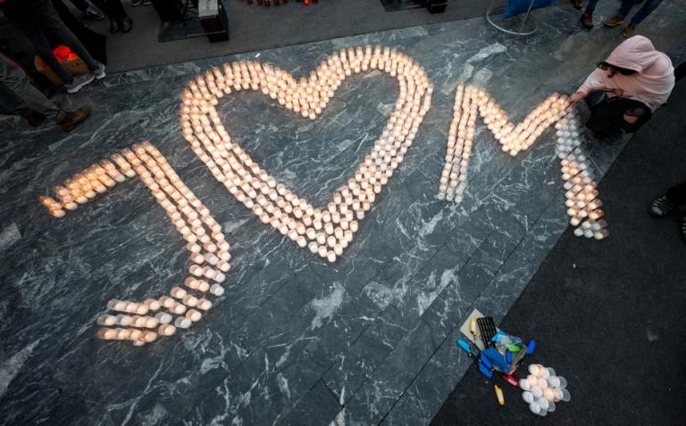 Candles were lit spellng out the love between, and for, Jan Kuciak and his fiancee Martina Kusnirova who were gunned down two years ago