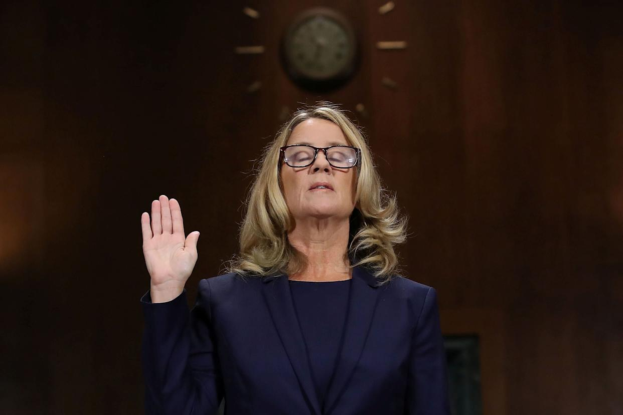 Christine Blasey Ford is sworn in before testifying. (Photo: POOL New / Reuters)