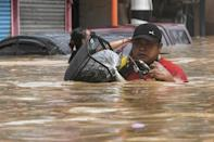 Flood water in some Manila streets was up to shoulder height