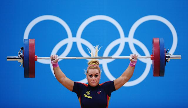 LONDON, ENGLAND - AUGUST 03: Lidia Valentin Perez of Spain competes in the Women's 75kg Weightlifting Final on Day 7 of the London 2012 Olympic Games at ExCeL on August 3, 2012 in London, England. (Photo by Laurence Griffiths/Getty Images)