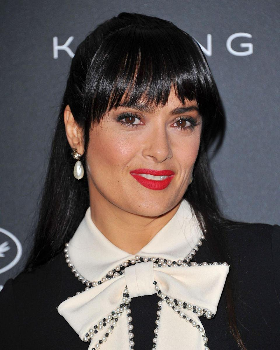 <p>2017's queen of Cannes transformations, Salma's fringe adds a French twist to her monochrome look.</p>