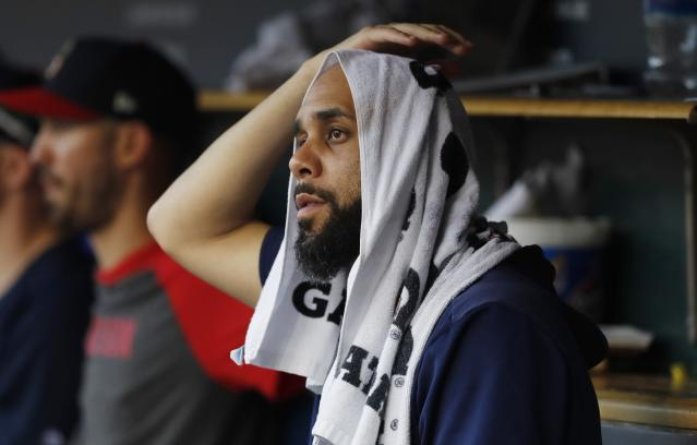 Boston Red Sox starting pitcher David Price sits in the dugout during the third inning of a baseball game against the Detroit Tigers, Friday, July 5, 2019, in Detroit. (AP Photo/Carlos Osorio)