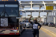 FILE - In this May 8, 2021, file photo, LaTosha Brown, co-founder of Black Voters Matter, stands atop the Edmund Pettus Bridge, a famous civil rights landmark in Selma, Ala. In the nation's capital on Saturday, Aug. 28, 2021, multiracial coalitions of civil, human and labor rights leaders including Brown's group, are convening rallies and marches to urge passage of federal voter protections that have been eroded since the Voting Rights Act of 1965. (AP Photo/Vasha Hunt, File)
