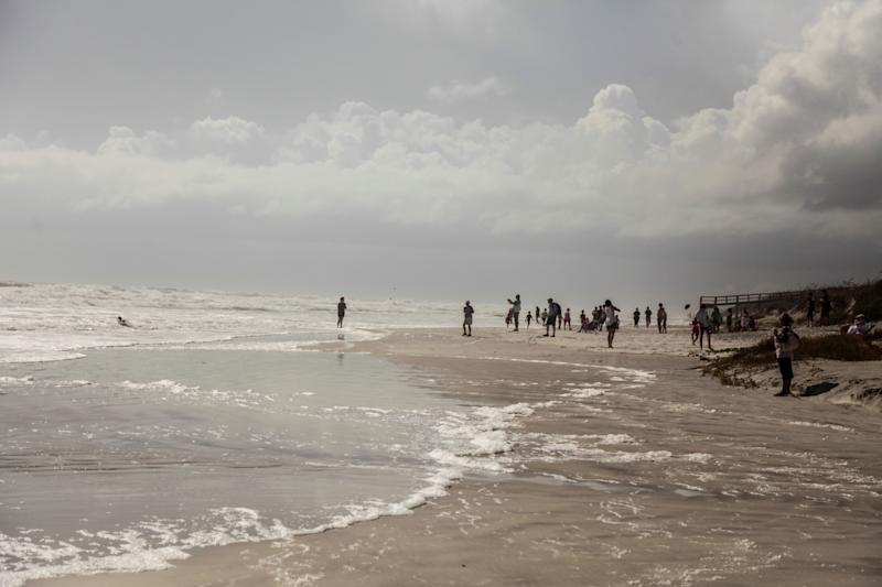 People watch waves at the beach as Hurricane Dorian makes its' way north, in St. Augustine, Florida, U.S. September 3, 2019. REUTERS/Maria Alejandra Cardona