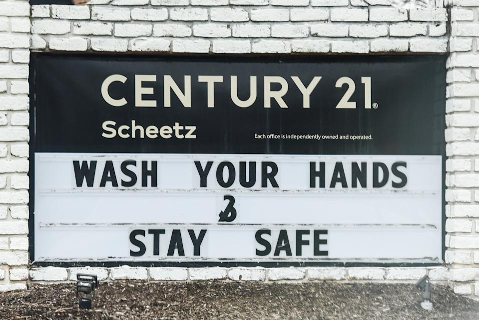 "Zionsville, IN - MARCH 21: A ""Wash Your Hands & Stay Safe"" sign outside of a Century 21 by Scheetz real estate building during the COVID-19 Coronavirus pandemic on March 21, 2020 in Zionsville, IN (Photo by James Black/Icon Sportswire via Getty Images)"
