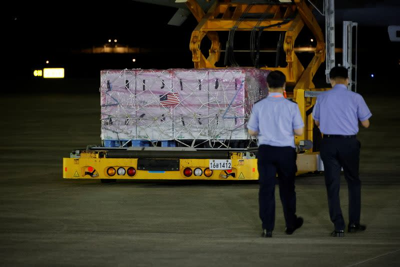 A batch of Johnson & Johnson's Janssen COVID-19 vaccines arrives at a military airport in Seongnam