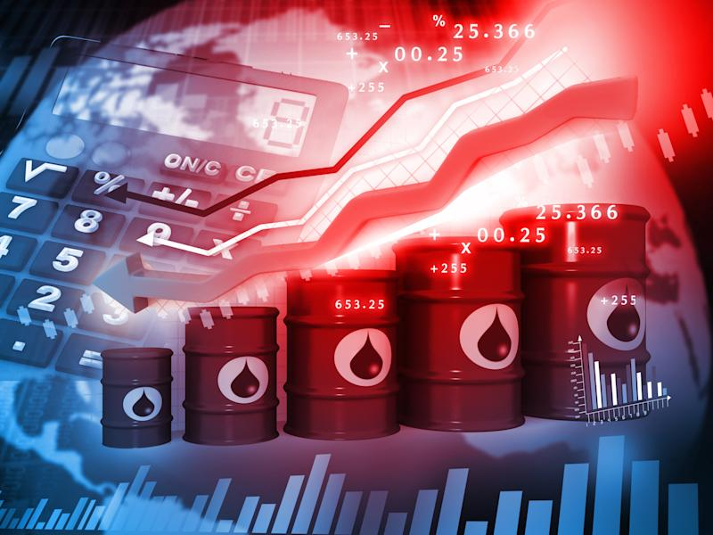 Barrels of oil with a red arrow and a calculator.