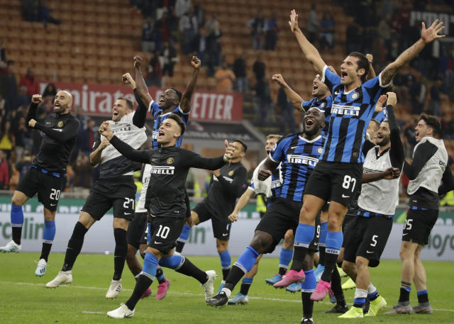 Inter Milan's players celebrate at the end of a Serie A soccer match between AC Milan and Inter Milan, at the San Siro stadium in Milan, Italy, Saturday, Sept.21, 2019. (AP Photo/Luca Bruno)