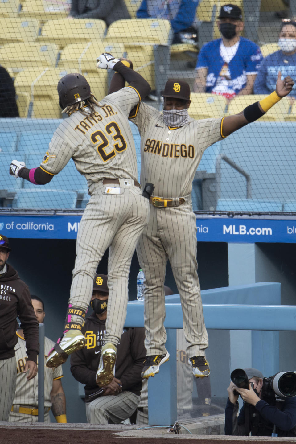 San Diego Padres' Fernando Tatis Jr., left, and Jurickson Profar celebrate Tatis' solo home run during the first inning of the team's baseball game against the Los Angeles Dodgers in Los Angeles, Saturday, April 24, 2021. (AP Photo/Kyusung Gong)
