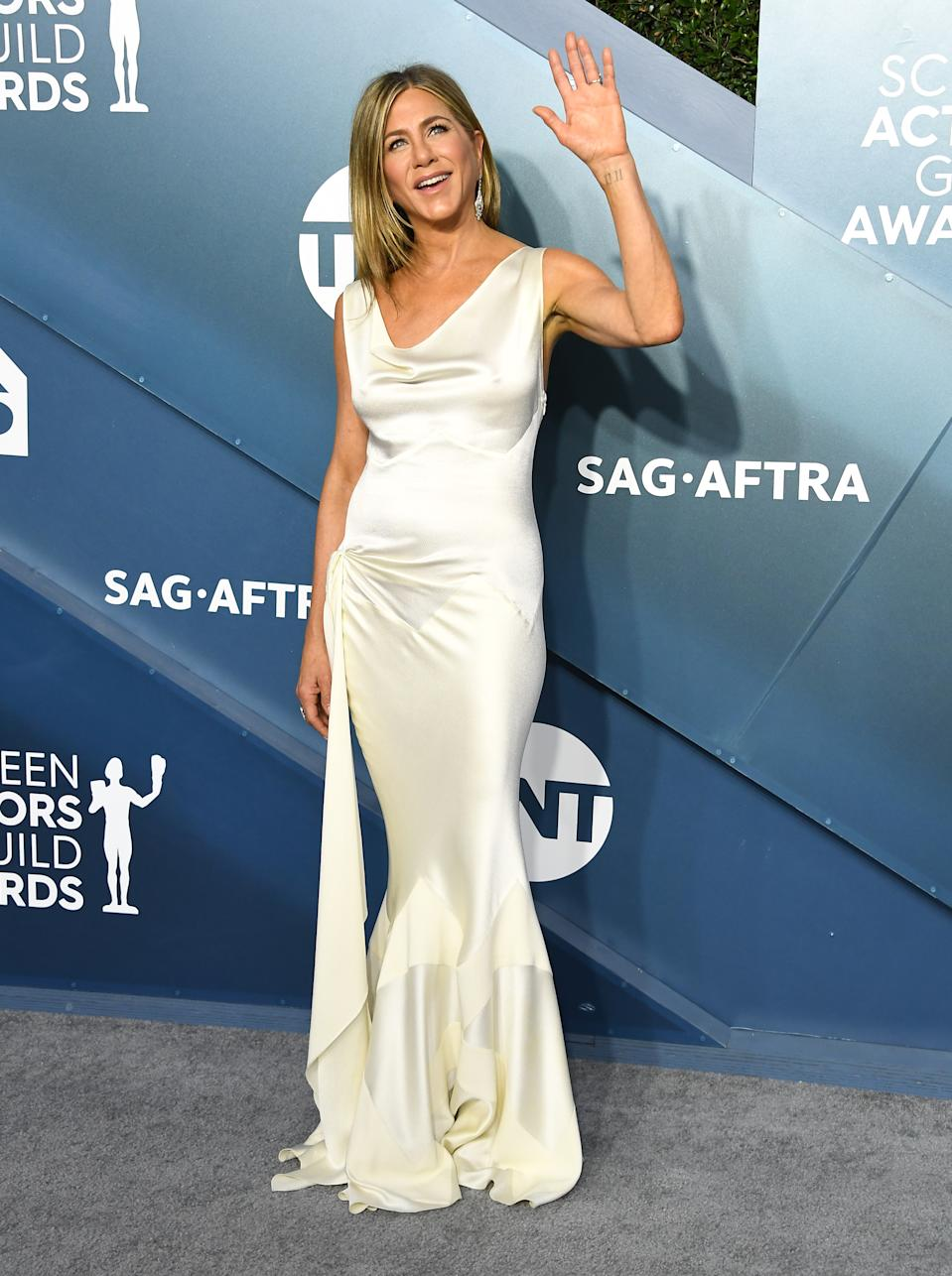 Jennifer Aniston's figure hugging Dior gown was the a red carpet hit at the 2020 Screen Actors Guild Awards.