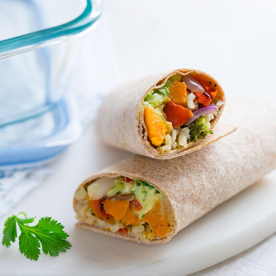"""<p>Use leftover brown rice and roasted veggies for this easy vegan lunch idea to pack for work. To serve this wrap warm, simply pop in the microwave for about a minute to warm through. <a href=""""https://www.eatingwell.com/recipe/262095/easy-brown-rice-veggie-wrap/"""" rel=""""nofollow noopener"""" target=""""_blank"""" data-ylk=""""slk:View Recipe"""" class=""""link rapid-noclick-resp"""">View Recipe</a></p>"""