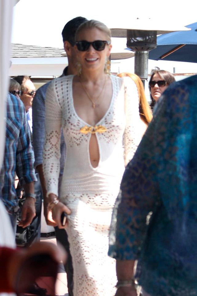 "Newlywed LeAnn Rimes was all smiles upon exiting Moonshadows restaurant in Malibu, California, following a post-wedding brunch. We, however, were all frowns when we spotted the country cutie in this crocheted Emilio Pucci catastrophe. Perhaps it's just us, but we think her revealing maxi dress looks like a bathing suit cover up. Discuss. <a href=""http://www.splashnewsonline.com"" target=""new"">Splash News</a> - April 25, 2011"