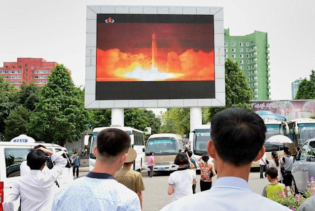 People watch a news report showing North Korea's Hwasong-14 missile launch at Pyongyang station, North Korea, on July 29, 2017. (Photo: Kyodo via Reuters)