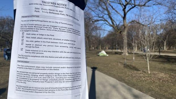 The city posted notices under Ontario's Trepass to Property Act on tents, wooden structures, light poles and trees across Toronto and in the city's four largest encampments on March 19, 2021. This one is in Trinity Bellwoods Park. (Paul Smith/CBC - image credit)